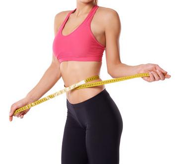 photodune-3775776-happy-slim-woman-measuring-her-waist-xs