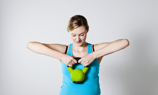 photodune-2907979-pregnant-woman-exercising-with-kettlebell-xs