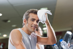 photodune-3837564-man-wiping-sweat-with-towel-at-health-club-xs