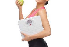 photodune-4786745-sporty-woman-with-scale-and-green-apple-xs