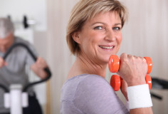 photodune-1509717-woman-using-dumbbells-in-a-gym-xs