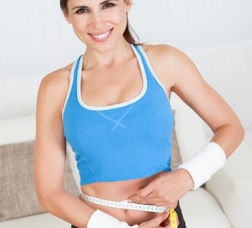 photodune-3008782-happy-woman-measuring-her-waist-xs