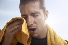 sweating young man with a towel
