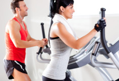 photodune-1445583-man-and-woman-with-elliptical-cross-trainer-at-gym-xs-1