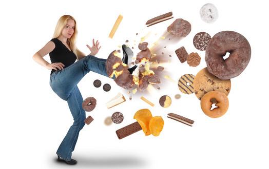 photodune-3370196-diet-woman-kicking-donut-snacks-on-white-xs-1