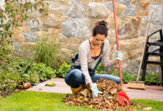 photodune-5582508-young-woman-raking-leaves-autumn-pile-veranda-xs-1