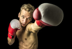 photodune-5891124-young-boxer-performing-a-punch-xs