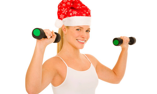 photodune-1414146-woman-with-santa-hat-lifts-weights-xs