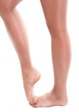 Legs of ballet dancer girl