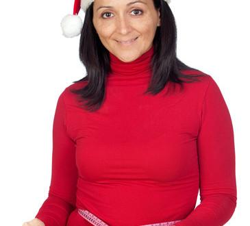photodune-3252256-beautiful-girl-with-christmas-hat-measuring-her-waist-xs