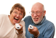photodune-3597550-happy-senior-couple-play-video-game-with-remote-controls-on-a-white-background-xs