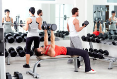 photodune-1445692-group-of-people-in-sport-fitness-gym-weight-training-xs