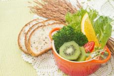 fusion food, fruit and vegetable salad in colorful cup with whol