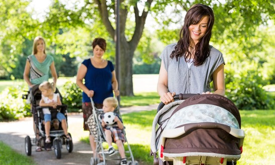 photodune-6701869-mother-looking-at-baby-in-stroller-at-park-xs