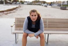 photodune-6258235-beautiful-young-woman-taking-a-break-from-running-xs-1