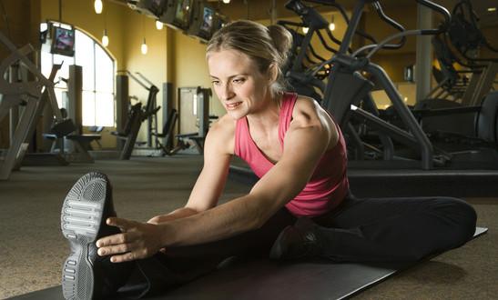 photodune-413510-woman-stretching-at-gym-xs