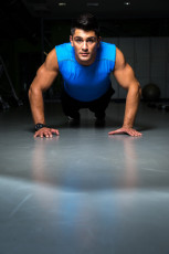 Man exercising in gym push ups