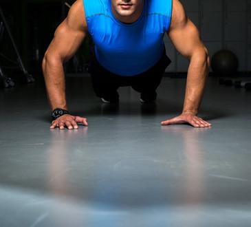 photodune-5414600-man-exercising-in-gym-push-ups-xs