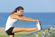 photodune-5471665-beautiful-sportswoman-stretching-with-the-sea-in-the-background-xs