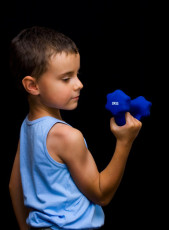 Cute kid doing fitness