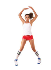 Young black woman jumping jack in shorts