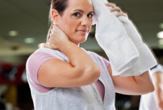 photodune-3219010-woman-wiping-sweat-with-towel-at-health-club-xs