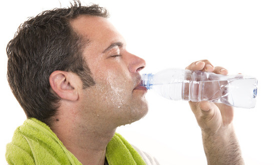 photodune-5318121-man-drinking-water-and-sweating-xs