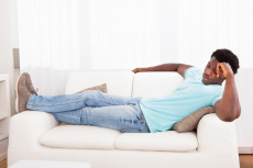 Lazy Man Chilling Out On Sofa