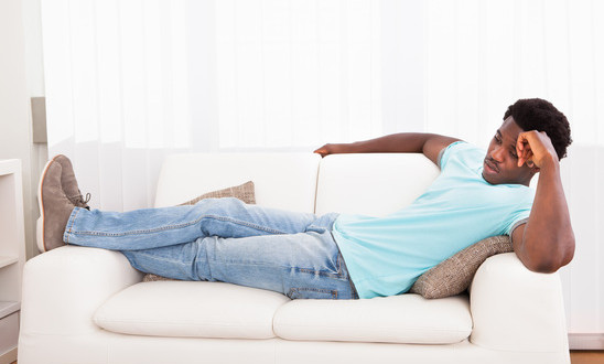 photodune-5401992-lazy-man-chilling-out-on-sofa-xs-1