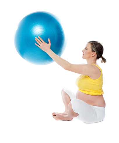 Attractive pregnant lady practicing yoga