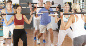 photodune-325092-group-of-people-lifting-weights-in-gym-xs-1
