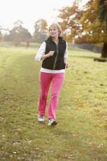 Senior Woman Power Walking In The Park