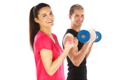 photodune-4479652-young-man-and-woman-lifting-weights-isolated-on-white-xs