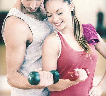 photodune-9129153-two-smiling-people-working-out-with-dumbbells-xs