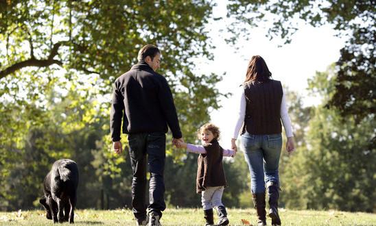 photodune-3420494-family-walking-their-dog-xs
