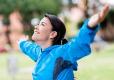 Happy woman exercising outdoors