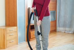 photodune-6518475-happy-mature-woman-vacuuming-with-vacuum-cleaner-xs-1