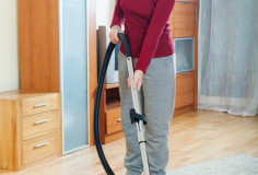 photodune-6518475-happy-mature-woman-vacuuming-with-vacuum-cleaner-xs-1
