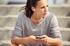 Female Athlete Listening to MP3 Music
