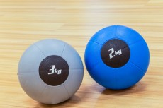 couple of medicine weight ball on wooden floor