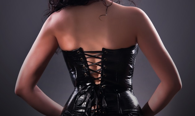 d70f047a78a desired brunette woman posing in leather corset