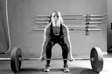 young woman on a weightlifting session - crossfit workout