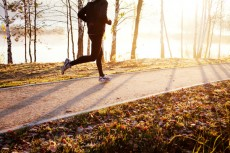 Man running at autumn during sunrise