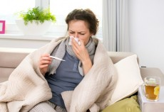 Sick Woman with Thermometer. Flu. Sneezing into Tissue