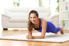 Fitness woman exercising at home
