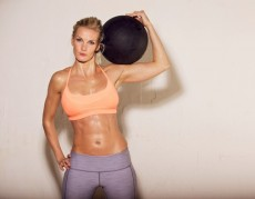 Sweaty Athlete with Ball on Her Shoulder