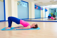 Pilates woman shoulder bridge exercise workout