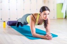 portrait fitness training athletic sporty woman doing plank exercise in gym or yoga class concept exercising workout aerobic