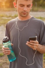 photodune-14711772-man-setting-the-music-playlist-for-the-workout-xs