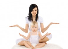 Mom and baby doing exercise, gymnastics, yoga, fitness and healt